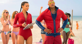 (L-R) Ilfenesh Hadera as Stephanie Holden and Dwayne Johnson as Mitch Buchannon in the film BAYWATCH by Paramount Pictures, Montecito Picture Company, FlynnPicture Co., and Fremantle Productions