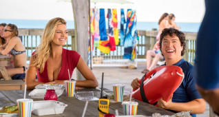 (L-R) Kelly Rohrbach as CJ Parker and Jon Bass as Ronnie in the film BAYWATCH by Paramount Pictures, Montecito Picture Company, FlynnPicture Co., and Fremantle Productions