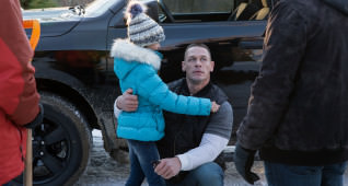 Adriana Costine plays Adrianna and John Cena plays Roger in Daddy's Home 2 from Paramount Pictures.